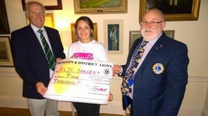 Joy from CLIC Sargent presented with £2000