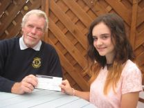 Girl Guide Phoebe Roberts receives £100 from Honiton Lions