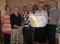 The Lions Ladies presenting the £250 to Hospiscare