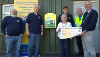 Lion President Steve donates £400 towards village defibrillator