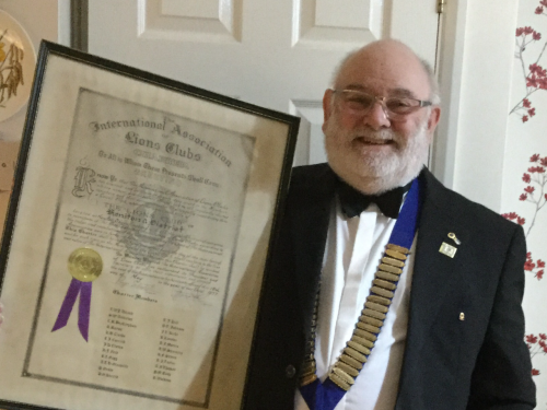 Brian Richards holding the original charter from 1977