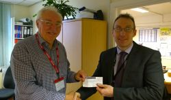 Lion Bob presents £100 to Matt Burrell from Honiton College for Senior citizens xmas party