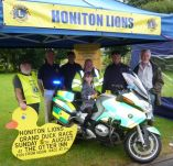 Honiton Lions with Daniel Lavery and Devon Freewheelers New BMW Bike