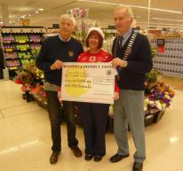 Lion President Ed with Lion Barry presenting Kim from Tesco with £233 cheque for Diabetes UK