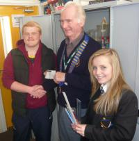 Lion President presenting £100 cheque to Students