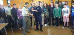 Lion Tom presenting the £150 cheque to Scouts