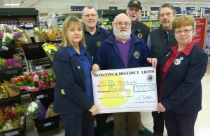 Julia Giles and Alison McKenzie receive £500 cheque from Lion Brian Richards