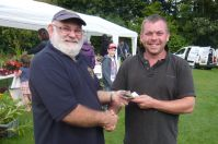 Lion president presenting winner with £150