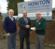 Lions Bill and Ed presenting £100 to Gary Wills from Honiton College