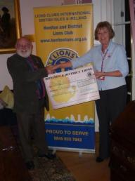 Cheque presentation to Maggie Little from DAAT