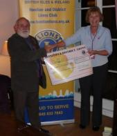 Lion Presideant from another angle presentating cheque for £1000