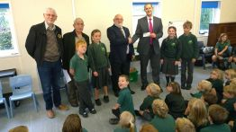 Handover of £500 towards the neew school library