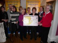 Mary Bolshaw receives the £500 for HOSPISCARE from Lions Ladies