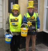 Lions John and Ed with big yellow hats collecting for Marie Curie