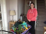 Winner of the wheelbarrow raffle Mrs Witt with the GOODS