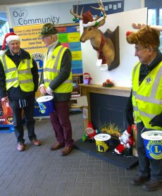 Lions Tom, Bernard and Roy at Tesco collecting at Easter
