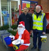 Lions John and Barnard with Santa Lion Barry
