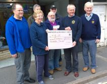 Lion President Steve with £1500 for Val Royle chairman of TRIP