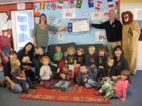 Presentation of cheque for 329 pounds to Upottery Preschool