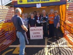 Lions Ladies line up in plate smashing stall ahainst Lion President Steve