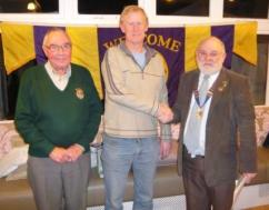 Lion President Brian and Lion Bill welcome Trevor to the club